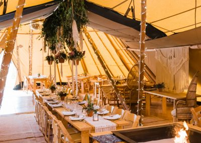Tipi wedding reception laid out waiting for guests