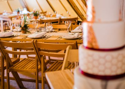 Wedding cake and tables set for tipi wedding, Scarborough